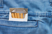 Jeans pocket with a packet of cigarettes — Stock Photo