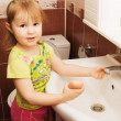 The little girl washes hands - Stock Photo
