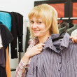 The girl chooses clothes in a boutique - Foto de Stock