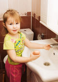 The little girl washes hands — Stock Photo