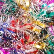 Christmas colour tinsel background - Stock Photo