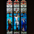 Stained-glass window in church - Stock Photo