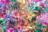 Christmas colour tinsel background — Stock Photo