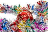 Christmas tinsel with a red toy — Stok fotoğraf