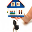 Concept of a hand holding house keys — Stock Photo