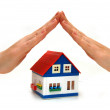 Hands over a small house — Stock Photo #2595807