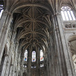 Inside in a Gothic cathedral of Paris - Stock Photo