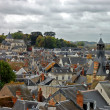 Roofs of a small city in France - Stock Photo