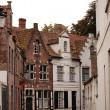 Very old small streets of Brugge - Stock Photo