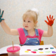 Small cute painting girl at home — Stock Photo