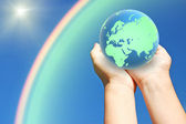 Globe of planet earth in hands — Stock Photo