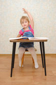 Small cute girl with hand up — Stock Photo