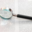 Magnifying Glass and document close up — Stock Photo