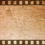 Retro grunge background with film strips — Stock Photo