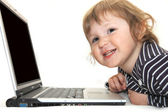 Baby girl working on laptop isolated white — Stock Photo