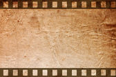 Retro grunge background with film strips — Stock Photo