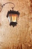 Old lantern on a vintage style background — Stock Photo