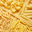 Four different kinds of italian pasta. Food back - Stock Photo