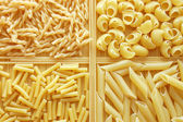 Four different kinds of italian pasta. Food back — Stock Photo