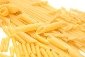 Various shapes of pasta background — Stock Photo