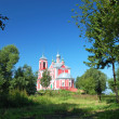 Russian nature against ancient church — Stock fotografie