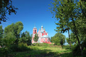 Russian nature against ancient church — Stock Photo