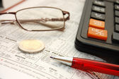 Glasses,pen and calculator — Stock Photo