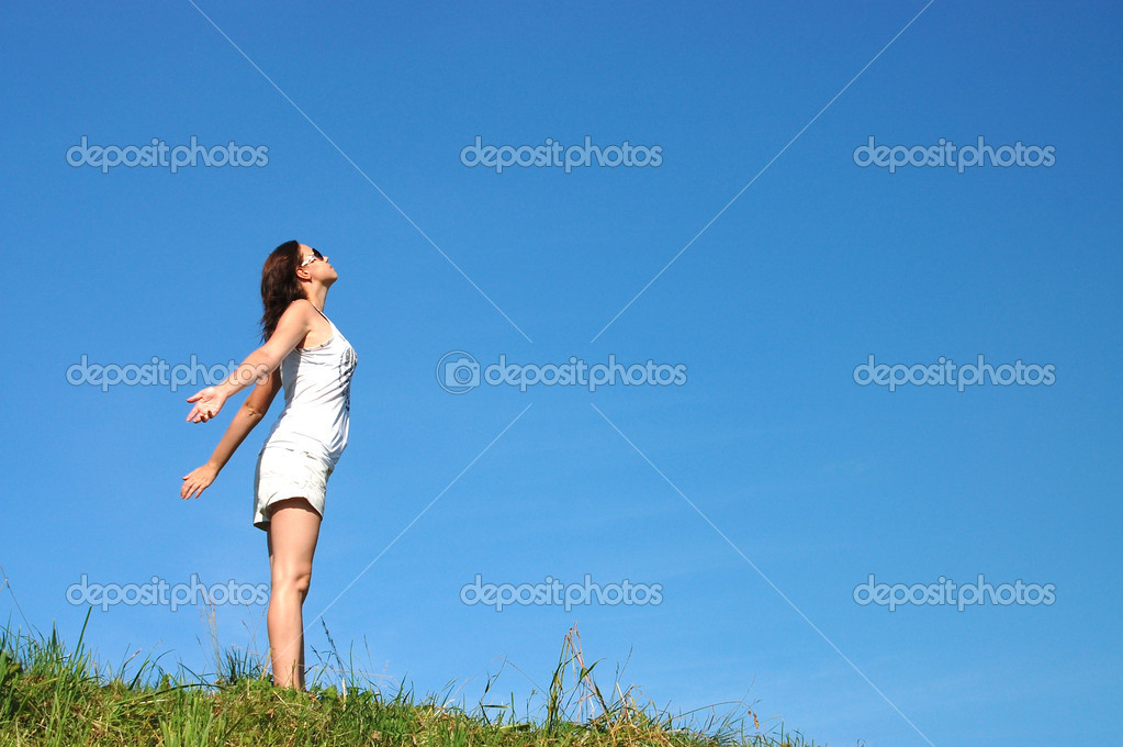 Woman feeling freedom surrounded by summer color stock image