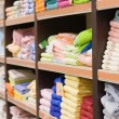 Shelf with towels in a supermarket - Stock Photo