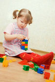 The little girl plays to a room — Stock Photo