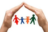 Family in house made of hands — Stock Photo