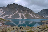 Blue lake in the mountains — Stock Photo