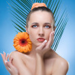 Stock Photo: Beautiful WomWith Orange Flower.