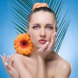 Beautiful Woman With The Orange Flower. — Stock Photo