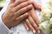 Two hands on a wedding dress — Stock Photo