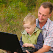 Father and son with laptop — Foto de Stock