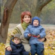 Mother with sons on the nature — Stock Photo