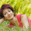Portrait of a mature woman in the park - Stock Photo
