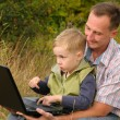 Stock Photo: Father and son with laptop