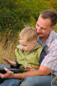 Father and son with laptop — Stock Photo