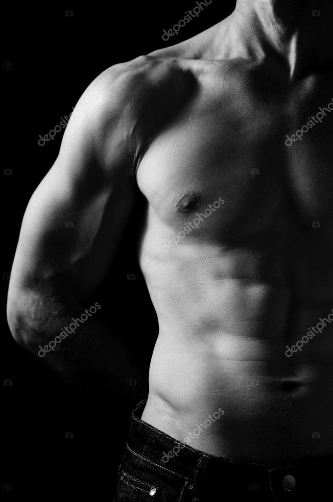 B&W young sporty man on black background — Stock Photo #1314441