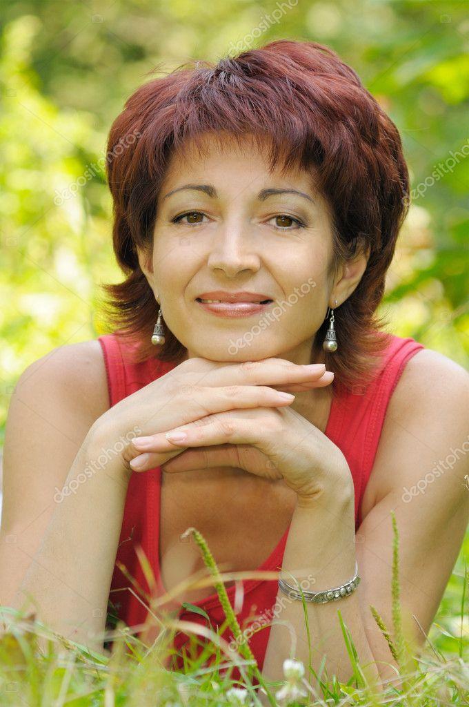 Portrait of a mature woman in the park — Stock Photo © pirita