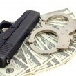 Black gun, bracelets and cash — Stock Photo