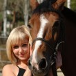 Beautiful girl and her horse — Stock Photo