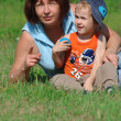 Grandmother and grandson in the park — Stock Photo #2253438