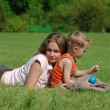 Mother and son on the green grass - Stock Photo