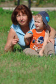 Grandmother and grandson in the park — Stock Photo