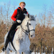 Girl on white dressage horse in winter — Stock Photo #2531197