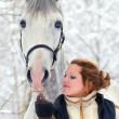 Girl and white horse in winter — Stock Photo