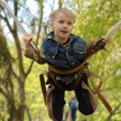 Boy jumping on the trampoline — Stock Photo